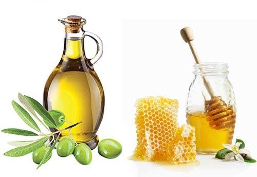 Mật ong và dầu oliu sẽ là trợ thủ đắc lực để bạn đối phó với mái tóc khô